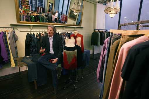 British designer Paul Smith speaks during an interview with Reuters at his office in central London