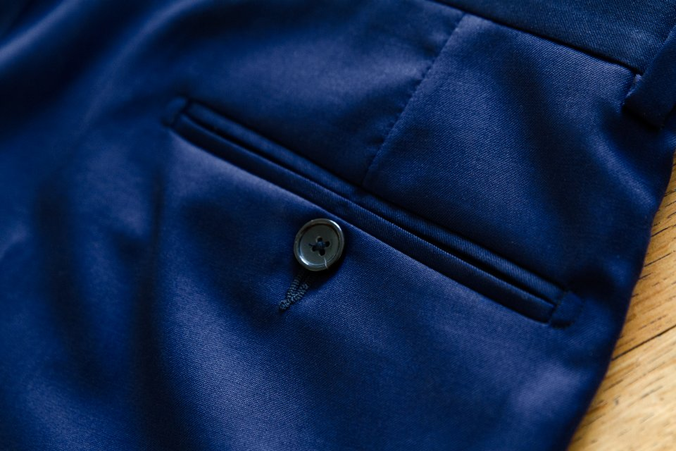 poche boutonnée pantalon