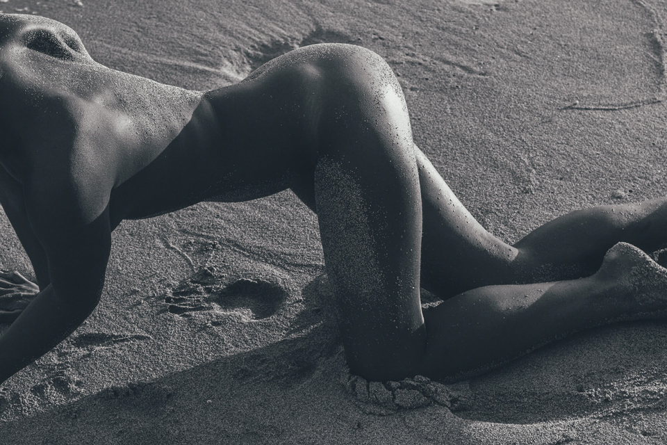 Woman body in the sand