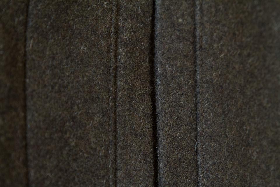 poche passepoilee laine
