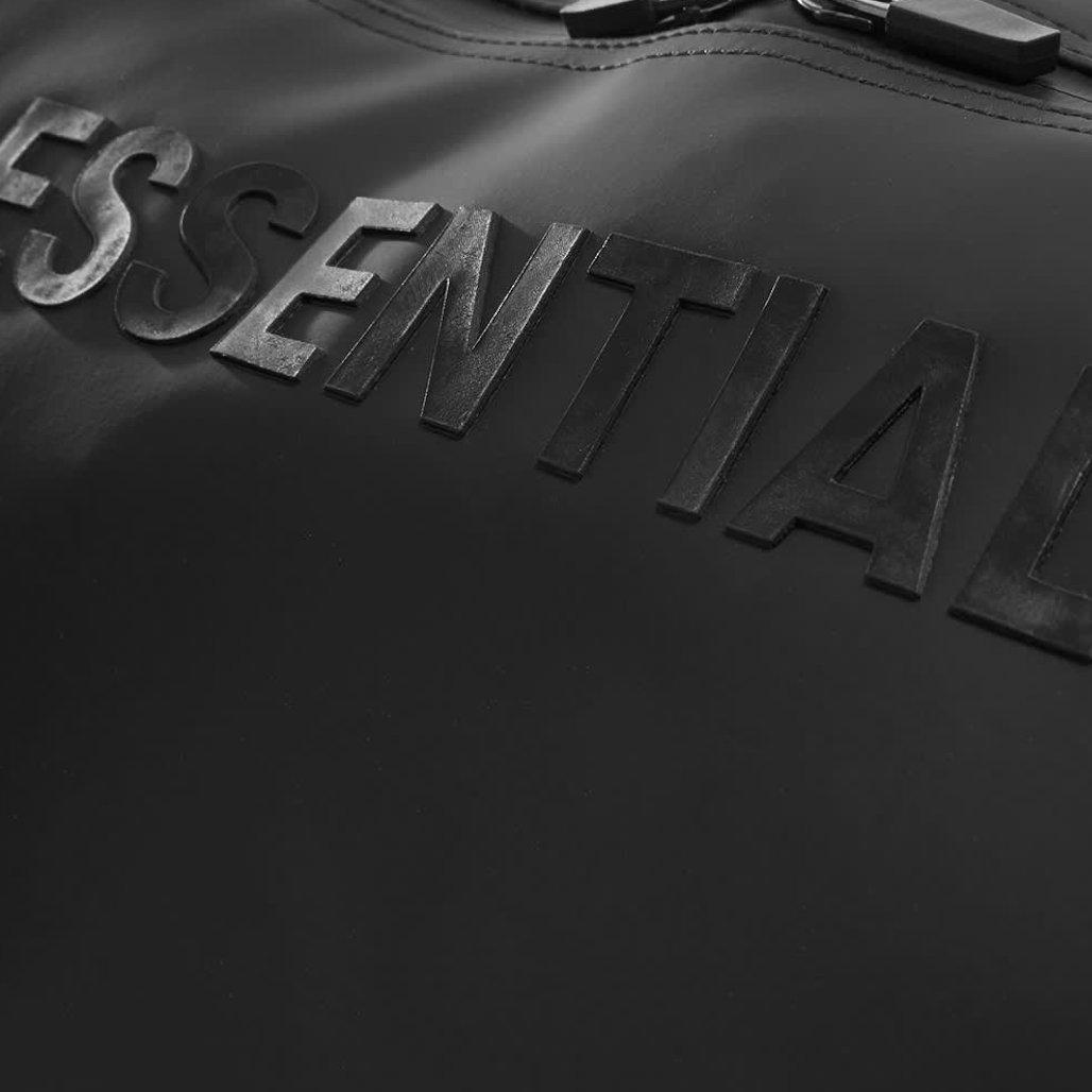 sac de voyage fear of god essentials logo
